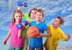 Group of sporty children friends with dumbbells and ball Royalty Free Stock Image
