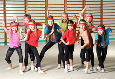 Group of sporty girls. In gym stock image