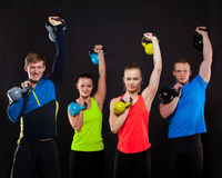 Group Of Sporty People With Kettlebells  Royalty Free Stock Image