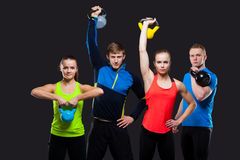 Group Of Sporty People With Kettlebells Isolated Stock Photography