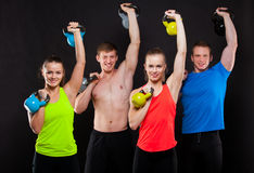 Group Of Sporty People With Kettlebells Isolated Stock Photos