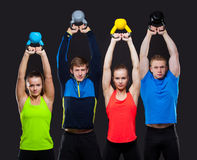 Group Of Sporty People With Kettlebells Isolated Stock Images