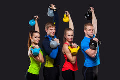 Group Of Sporty People With Kettlebells Isolated Royalty Free Stock Photos