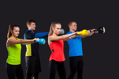 Group Of Sporty People With Kettlebells Isolated Stock Image