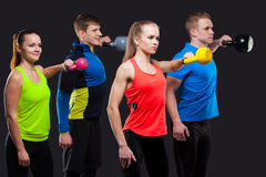Group Of Sporty People With Kettlebells Isolated Royalty Free Stock Photo