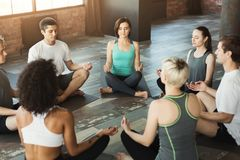 Diverse group meditating in yoga class royalty free stock image