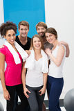 Group of sporty young people at the gym Stock Photography