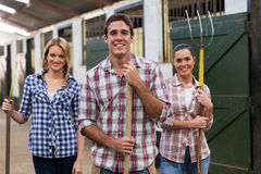 Group stable workers Stock Photography