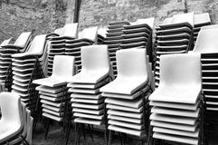 Group of stacked plastic chairs. Black and white photo Royalty Free Stock Photography