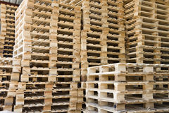 Group of stacked wooden transport pallets Stock Images