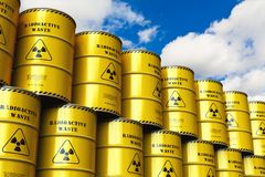 Group of stacked yellow drums with radioactive waste against blu. Creative abstract nuclear power fuel manufacturing, disposal and utilization industry concept Stock Photo