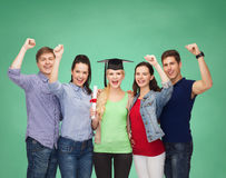 Group of standing smiling students with diploma Royalty Free Stock Images
