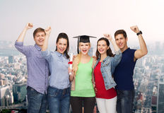 Group of standing smiling students with diploma Royalty Free Stock Image