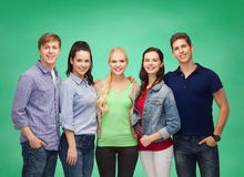 Group of standing smiling students Stock Photos