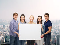 Group of standing students with blank white board Stock Photography