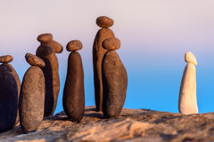 Group of stones on coast. White stone confront to black group on the seashore Stock Photo