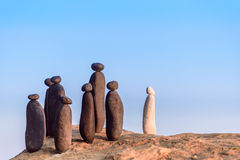 Group of stones. White stone confront to black group on the seashore Stock Image