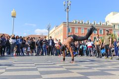 Group of street dancers performing a break dance routine Royalty Free Stock Image