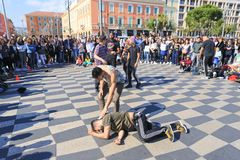 Group of street dancers performing a break dance routine Stock Photos