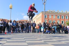 Group of street dancers performing a break dance routine Royalty Free Stock Photography
