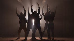 Group of street dancers performing different moves on the dark street. stock video footage