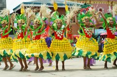 A group of street dancers in various costumes dance at church plaza. Tiaong, Quezon, Philippines - June 22, 2016: a group of street dancers in various costumes Royalty Free Stock Photography