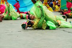 A group of street dancers in various costumes dance at church plaza. Tiaong, Quezon, Philippines - June 22, 2016: a group of street dancers in various costumes Stock Photos