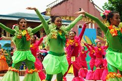 A group of street dancers in various costumes dance at church plaza. Tiaong, Quezon, Philippines - June 22, 2016: a group of street dancers in various costumes Stock Photo