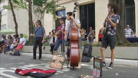 Group of street musicians playing at street stock video footage