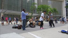Group of street musicians playing at street stock video