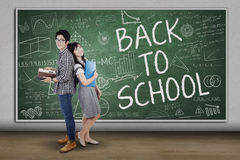 Group of student back to school. Group of student standing in the class with a text of back to school on blackboard Royalty Free Stock Photo