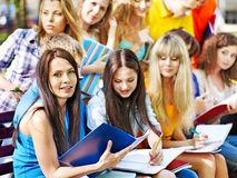 Group student on bench outdoor. Royalty Free Stock Image