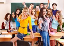 Group student in classroom near blackboard. Stock Photography