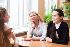 Group of student girls during a brake between classes Stock Image