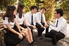 A group of student have fun talking and playing in the garden. Bangkok, Thailand - November 17, 2015 Royalty Free Stock Photos