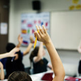 Group of student learning arms raised Royalty Free Stock Image