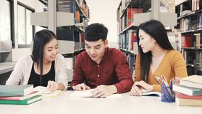 Group of student student reading book. In college library stock footage