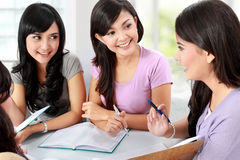 Group of student studying together Stock Images