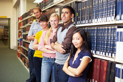 Group of students. Leaning on book shelf Royalty Free Stock Images