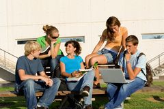 Group students. Group of students studying with laptop and books Royalty Free Stock Photography