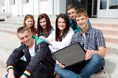Group students against the background an acad Royalty Free Stock Images