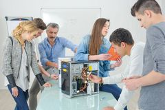 Group students around dismantled computer. Group of students around dismantled computer Royalty Free Stock Image