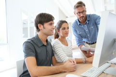 Group of students attending class with professor Stock Photography