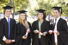 Group Of Students Attending Graduation Ceremony Stock Photo