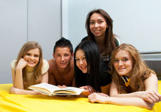 Group of students with the book Royalty Free Stock Images