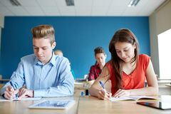 Group of students with books writing school test stock photo