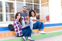 Group of students in Campus. Group of students sitting on school stairs Stock Photo