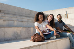 Group of students in Campus. Group of students sitting on school stairs Royalty Free Stock Images