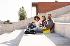 Group of students in Campus. Group of students sitting on school stairs Stock Photography