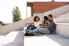 Group of students in Campus. Group of students sitting on school stairs Royalty Free Stock Photo